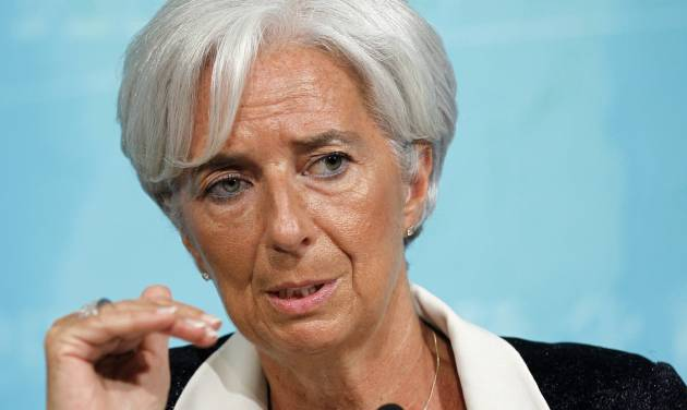 FILE - This July 3, 2012 file photo shows International Monetary Fund Managing (IMF) Director Christine Lagarde speaking in Washington. Lagarde travels the world trying to keep the global economy on track. But some of the greatest threats are brewing just blocks from her Washington office. And there's little she can do about them. The IMF has been left largely on the sidelines as Democratic and Republicans fights over the budget raise the specter of a U.S. default or possibly drive the country into recession. (AP Photo/Haraz N. Ghanbari, File)