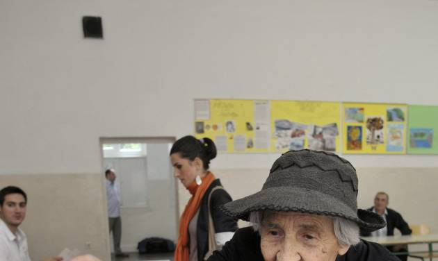 A woman casts her ballot at a polling station in downtown Podgorica, Montenegro, Sunday, Oct. 14, 2012. Djukanovic is again a favorite to win weekend parliamentary elections in the tiny Balkan nation seeking membership in the European Union. (AP Photo/Risto Bozovic)