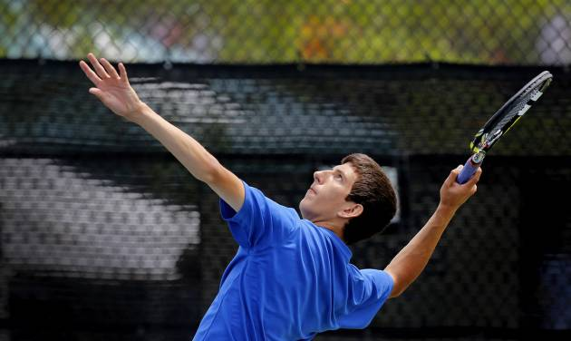 Mt. St. Mary High School's Blake Crawford during a serve to  Lucas Meacham as the pair competed in the Class 4A no. 1 singles championship match at the state championship tennis tournaments at the OKC Tennis Center on N. Portland Saturday afternoon, May 17, 2014. Crawford defeated Meacham of Crossings Christian to win the  championship. Photo by Jim Beckel, The Oklahoman