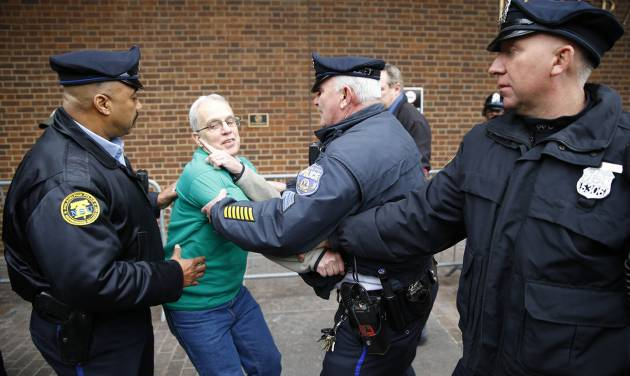 Police detain a protester demonstrating in opposition to the proposed Keystone XL oil pipeline, Monday, March 10, 2014, outside the Federal Building in Philadelphia. The protestors say the pipeline would contribute to global warming. (AP Photo/Matt Rourke)