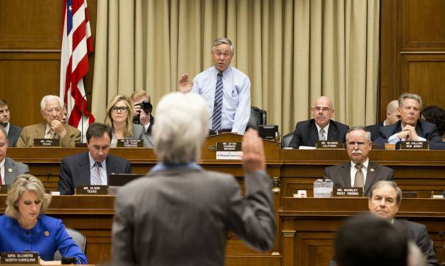 Health and Human Services Secretary Kathleen Sebelius is sworn in on Capitol Hill in Washington, Wednesday, Oct. 30, 2013, by House Energy and Commerce Committee Chairman Rep. Fred Upton, R-Mich., prior to testifying before the committee's hearing on the difficulties plaguing the implementation of the Affordable Care Act. Sebelius, President Barack Obama's top health official faced tough questioning by a congressional committee Wednesday that will demand she explain how the administration stumbled so badly in its crippled online launch of the president's health care overhaul.  (AP Photo/ Evan Vucci)