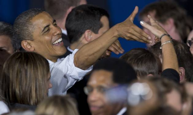 President Barack Obama reaches to shake a hand as he greets people after speaking at a campaign event at Mentor High School, Saturday, Nov. 3, 2012, in Mentor, Ohio, before traveling to Milwaukee for another Campaign event. (AP Photo/Carolyn Kaster)