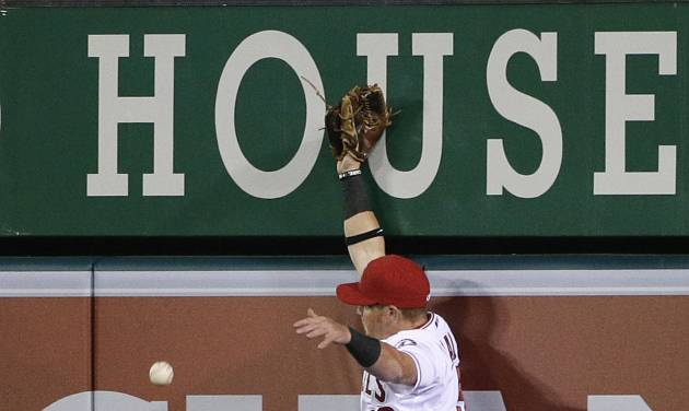 Los Angeles Angels right fielder Kole Calhoun can't catch an RBI double by Seattle Mariners' Dustin Ackley during the sixth inning of a baseball game Tuesday, April 1, 2014, in Anaheim, Calif. (AP Photo/Jae C. Hong)