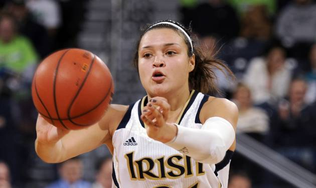 Notre Dame guard Kayla McBride throws a pass in the second half of an NCAA college basketball game with Boston College, Thursday, Jan. 9, 2014 in South Bend, Ind. Notre Dame won 95-53 with McBride leading all scorers with 20 points. (AP Photo/Joe Raymond)