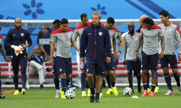 United States' Jurgen Klinsmann, center, walks on the pitch with his team during a training session at the Arena da Amazonia in Manaus, Brazil, Sunday, June 22, 2014. The U.S. will play Portugal in group G of the 2014 soccer World Cup on June 22. (AP Photo/Paulo Duarte)