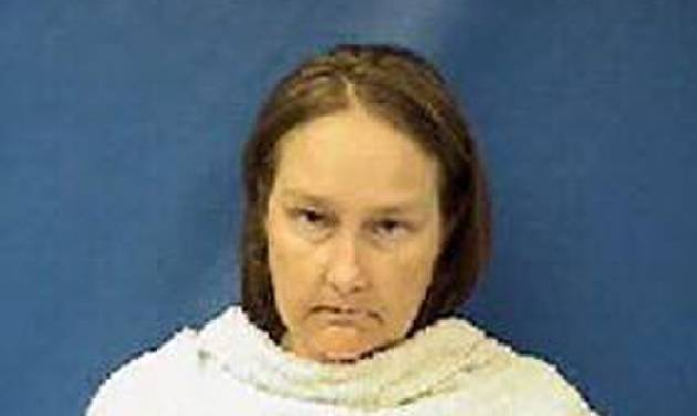 Kim Williams, wife of former Kaufman County justice of the peace Eric Williams, is seen in an undated photo provided by the Kaufman County Sheriff. Kim Williams was charged with capital murder after confessing to her involvement in the three shooting deaths of the local district attorney, his wife and an assistant prosecutor, authorities said Wednesday, April 17, 2013. Williams was arrested early Wednesday, a day after she told investigators that she and her husband were involved in the shootings of the Kaufman County district attorney, his wife and one of his prosecutors, according to documents in the case. Kaufman County District Attorney Mike McLelland and assistant prosecutor Mark Hasse prosecuted Eric Williams last year for theft of three computer monitors. Williams was convicted and sentenced to probation. He also lost his elected position as justice of the peace and his law license. (AP Photo/Kaufman County Sheriff)