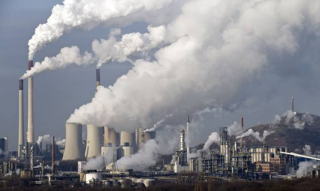 FILE - In this Dec. 16, 2009 file photo, steam and smoke rise from a coal burning power plant in Gelsenkirchen, Germany. A United Nations report on rising greenhouse gas emissions reminded world governments Wednesday, Nov. 21, 2012 that their efforts to fight climate change are far from enough to meet their stated goal of limiting global warming to 2 degrees C (3.6 F). (AP Photo/Martin Meissner, File)