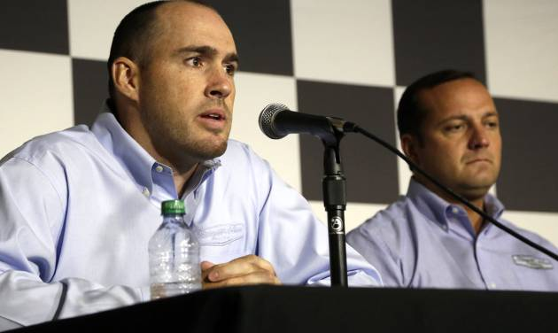 Stewart-Haas Racing executive vice president Brett Frood, left, speaks during a news conference as crew chief Greg Zipadelli looks on, at right, at Michigan International Speedway on Friday, Aug. 15, 2014. Tony Stewart will not race Sunday at Michigan International Speedway, skipping a second straight NASCAR Sprint Cup race since striking and killing a driver in a dirt-track race at a small New York track. Jeff Burton will drive Stewart's No. 14 Chevrolet in Michigan. (AP Photo/The Jackson Citizen Patriot, Brian Smith) ALL LOCAL TELEVISION OUT; ALL LOCAL INTERNET OUT