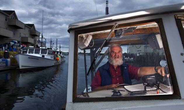 In this photo made Wednesday, Sept. 25, 2013, Casco Bay waterkeeper Joe Payne pilots his vessel in Portland, Maine. When Payne was hired 22 years ago to be the environmental steward of Casco Bay, there were only a handful of water keepers in the world. Now, there are 209 of them that oversee and protect bays, rivers, sounds, channels, inlets, lakes and creeks in 23 countries, on six continents. (AP Photo/Robert F. Bukaty)