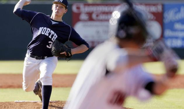 Edmond North pitcher Kyle Stephens delivers against Owasso in their first round game in the OSSAA 6A State Baseball Championship in Claremore, OK, May 10, 2012. MICHAEL WYKE/Tulsa World