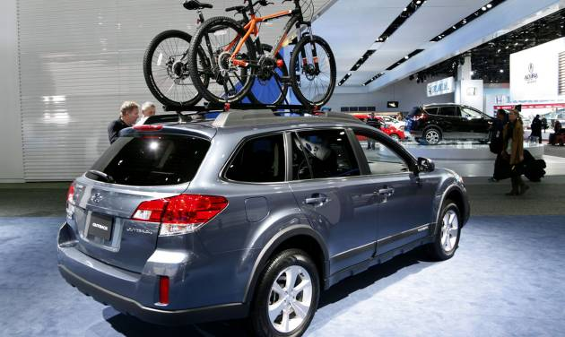 Bicycles are shown as accessories on the Suburu Outback wagon at the North American International Auto Show in Detroit, Wednesday, Jan. 16, 2013. Transportation of the two-wheeled variety is sharing the floor at the auto show in Detroit along with the latest cars, trucks and concept vehicles. Bikes weren't the focus of presentations during this week's press previews, but they're often used in marketing cars. (AP Photo/Paul Sancya)