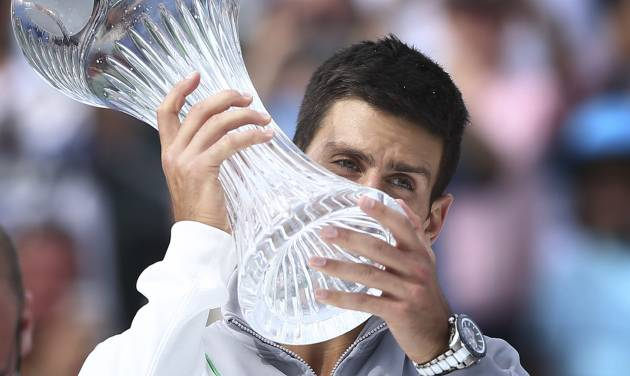 Novak Djokovic, of Serbia, holds his winner's trophy after defeating Rafeal Nadal, of Spain, 6-3, 6-3 during the Sony Open Tennis in Key Biscayne, Fla., Sunday, March 30, 2014. (AP Photo/J Pat Carter)