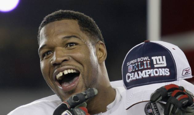 FILE - In this Feb. 3, 2008, file photo, New York Giants defensive end Michael Strahan celebrates after the Giants defeated the New England Patriots 17-14 in the Super Bowl XLII football game in Glendale, Ariz. While Strahan was a game-changer on the field, he was making his mark elsewhere with his gregarious personality, gap-toothed smile and willingness to step out of his comfort zone. He became a regular in commercials,  (AP Photo/David J. Phillip, File)