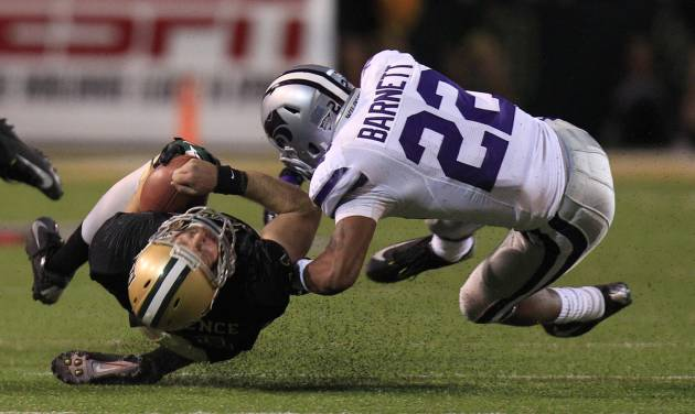 Baylor quarterback Nick Florence (11) gets a late hit while trying to slide on the keeper against Kansas State defensive back Dante Barnett (22) during the first half of an NCAA college football game Saturday, Nov. 17, 2012, in Waco Texas. A penalty against Barnett was called on the play. (AP Photo/LM Otero)