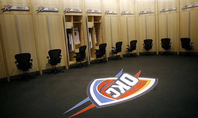 The new Oklahoma City Thunder locker room features a dining-table-size, marble terrazzo Thunder logo in the middle of the floor. PHOTO BY JOHN CLANTON, THE OKLAHOMAN