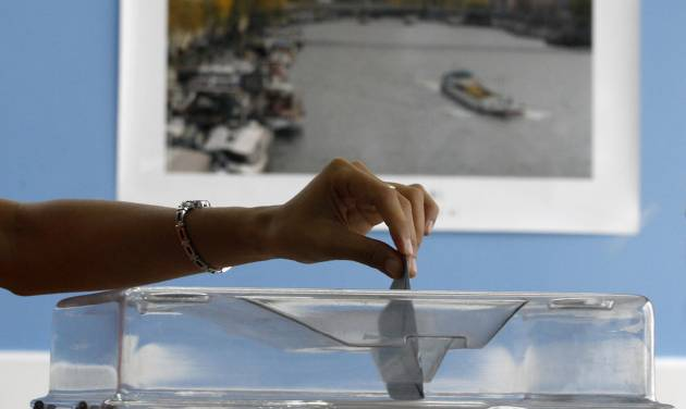 A French citizen casts her vote in her country's presidential election at an overseas voting center inside the French Embassy in Makati, south of Manila, Philippines on Sunday, Mayl 6, 2012. French citizens are choosing between Conservative President Nicolas Sarkozy and Socialist challenger Francois Hollande as they vote during the final round of presidential elections Sunday.(AP Photo/Aaron Favila)