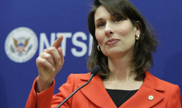 FILE - In this Jan. 24, 2013, file photo, National Transportation Safety Board Chairman Deborah Hersman points to a reporter during a news conference in Washington. The use of lithium ion batteries to power aircraft systems isn't necessarily unsafe despite a battery fire in one Boeing 787 Dreamliner and smoke in another, but manufacturers need to build in reliable safeguards, Hersman said Wednesday, Feb. 6, 2013. (AP Photo/Manuel Balce Ceneta, File)