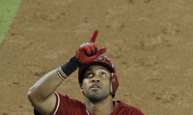 Arizona Diamondbacks' Chris Young points skyward as he rounds the bases after hitting a three-run home run against the Houston Astros in the sixth inning during a baseball game on Sunday, July 22, 2012, in Phoenix.(AP Photo/Ross D. Franklin)
