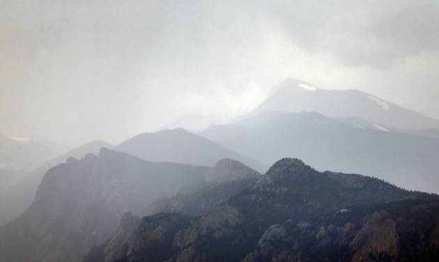 A storm gathers over Rocky Mountain National Park just west of Estes Park, Colo., Monday, July 14, 2014. Two fatal lightning strikes on consecutive days the previous weekend pinpoint dangers not always apparent to visitors to the 11,000-foot exposed high country of the park. Afternoon storms visible miles away arrive overhead suddenly. (AP Photo/Brennan Linsley)