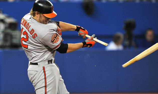 Baltimore Orioles' Mark Reynolds breaks his bat hitting a single against the Toronto Blue Jays during the third inning of a baseball game in Toronto, Tuesday, Sept. 4, 2012. (AP Photo/The Canadian Press, Aaron Vincent Elkaim)