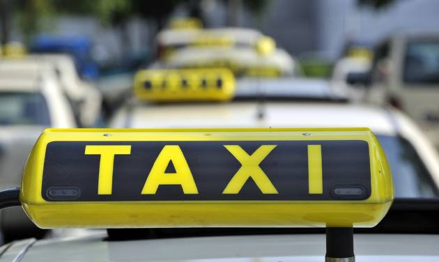 FILE - In this June 15, 2009 file photo taxi cabs are seen at Tegel Airport in Berlin. A court has issued an injunction barring ridesharing service Uber from operating in Germany, the latest shot in a fight with the country's taxi drivers. Frankfurt state court spokesman Arne Hasse said Tuesday, Sept. 2, 2014 its decision that Uber can't offer its services without a specific permit under German transport laws applies nationwide. (AP Photo/Gero Breloer, File)