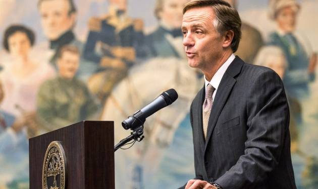 Republican Gov. Bill Haslam speaks in front a painting of Tennessee historical figures in the Old Supreme Court Chamber of the state Capitol in Nashville, Tenn., on Monday, March 25, 2013. Haslam was expected to address a joint session of the General Assembly on Wednesday to announce his recommendation on whether to expand Medicaid under the federal health care overhaul. (AP Photo/Erik Schelzig)