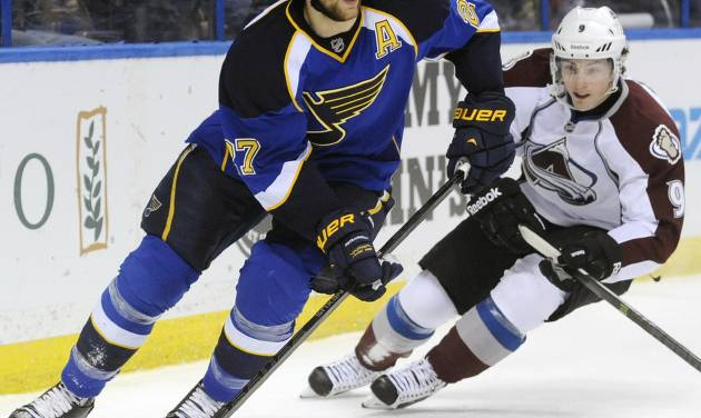 St. Louis Blues' Alex Pietrangelo (27) controls the puck around Colorado Avalanche's Matt Duchene (9) in the first period of an NHL hockey game Tuesday, April 23, 2013, in St. Louis. (AP Photo/Bill Boyce)