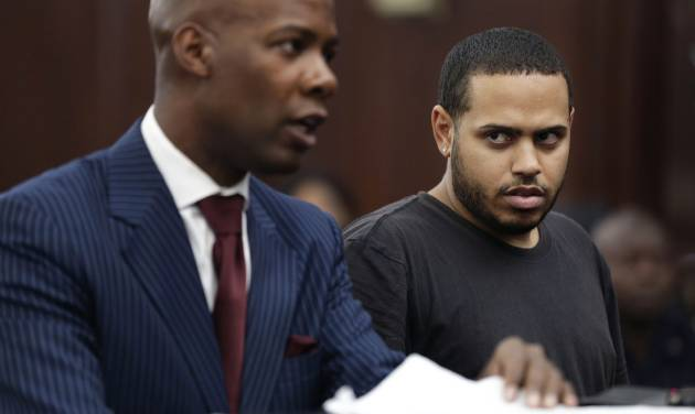 Christopher Cruz, right, appears in criminal court with his lawyer H. Benjamin Perez in New York, Wednesday, Oct. 2, 2013.  Cruz, 28, of New Jersey, was charged Wednesday with reckless driving after prosecutors said he touched off a tense encounter with the driver of a sport utility vehicle and a throng of other bikers that ended with blood and broken bones on a Manhattan street. He was also charged with unlawful imprisonment. His bail was set at $1,500 cash.  (AP Photo/Seth Wenig)