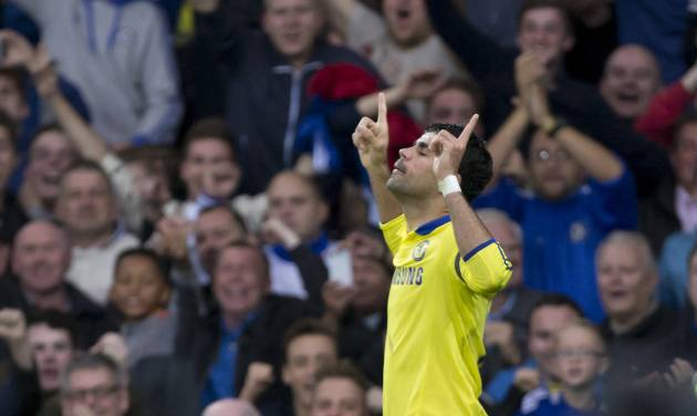 Chelsea's Diego Costa celebrates after scoring his second goal against Everton during their English Premier League soccer match at Goodison Park Stadium, Liverpool, England, Saturday Aug. 30, 2014. (AP Photo/Jon Super)