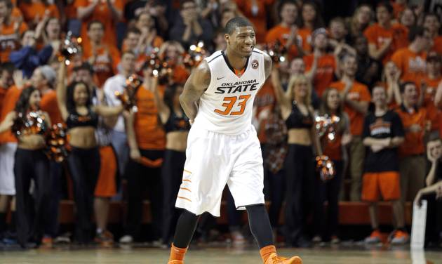 OSU's Marcus Smart smiles after a Cowboy score during Saturday's victory against Texas Tech. Photo by Sarah Phipps, The Oklahoman