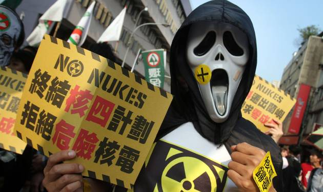 "A protester holds a slogan reading ""Stop Nuclear Power Plant 4. Refuse Dangerous Nuke"" during an anti-nuclear demonstration in Taipei, Taiwan, Saturday, March 9, 2013. Tens of thousands of Taiwanese have protested to demand that the government scrap a $10 billion nuclear power plant that is nearly complete and slated to begin operating in two years. (AP Photo/Chiang Ying-ying)"