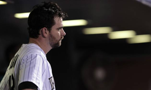 Colorado Rockies relief pitcher Boone Logan (48) stands in the dugout in the 12th inning of a baseball game after he gave up the go-ahead home run to Chicago Cubs' Javier Baer in Denver on Tuesday, Aug. 5, 2014. Chicago won 6-5. (AP Photo/Joe Mahoney)