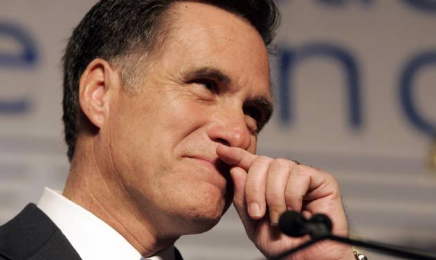 "FILE - In this Feb. 7, 2008, file photo, former Massachusetts Gov. Mitt Romney wipes his lip during a speech before the Conservative Political Action Conference in Washington, where he announced he was suspending his presidential campaign. Romney pulled the plug on his first presidential run and immediately served notice that he wasn't about to fade away. ""I hate to lose,"" he told conservatives that day. (AP Photo/Steve Helber, File)"
