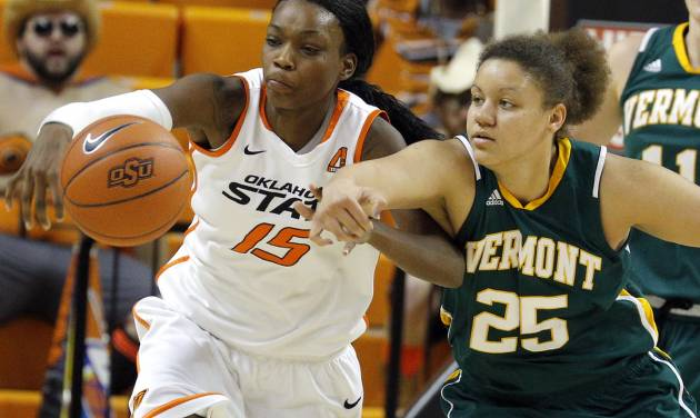 Oklahoma State's Toni Young (15) fights for Vermont's Kaylea Britton (25) for a loose ball during the women's college basketball game between Oklahoma State University and Vermont at Gallagher-Iba Arena in Stillwater, Okla., Sunday,Dec. 16, 2012. Photo by Sarah Phipps, The Oklahoman