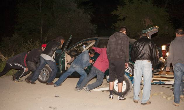 Family members and friends prepare to tow the vehicle of missing hikers Nicholas Cendoya, 19, and Kyndall Jack, 18, early Wednesday April 3, 2013 in Cleveland National Forest in Trabuco Hills in Southern California. The hikers were reported missing Sunday.(AP Photo/Kevin Warn)