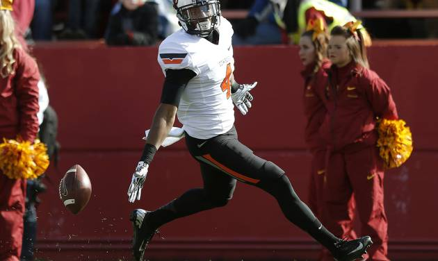 Oklahoma State 's Justin Gilbert (4) celebrates a interception for touchdown during the college football game between the Oklahoma State University (OSU) and Iowa State University (ISU) at Jack Trice Stadium in Ames, Iowa., Saturday, Oct. 26, 2013. Photo by Sarah Phipps, The Oklahoman