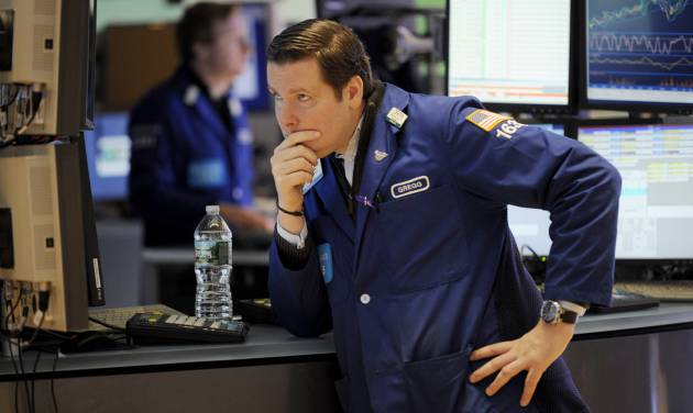 """Gregg Maloney of Barclays works on the floor of the New York Stock Exchange the day after Pres. Barack Obama was re-elected, Wednesday, Nov. 7, 2012 in New York.With President Barack Obama elected to another term, U.S. investors dumped stocks Wednesday and turned their focus to a world of problems, including a """"fiscal cliff"""" of tax increases and spending cuts at home and a deepening recession in Europe. (AP Photo/Henny Ray Abrams)"""