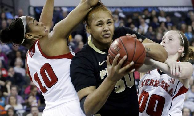 Purdue forward Taylor Manuel, center, drives to the basket against Nebraska forward Meghin Williams, left, and guard Lindsey Moore during the first half of an NCAA college basketball game in the Big Ten Conference tournament in Hoffman Estates, Ill., on Saturday, March 9, 2013. (AP Photo/Nam Y. Huh)