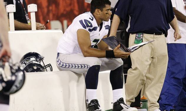 Seattle Seahawks quarterback Russell Wilson (3) sits on the bench during the fourth quarter of an NFL football game against the San Francisco 49ers in San Francisco, Thursday, Oct. 18, 2012. The 49ers won 13-6. (AP Photo/Tony Avelar)