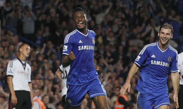 Chelsea's Mikel, left celebrates after scoring a goal against Fulham during the English Premier League soccer match between Chelsea and Fulham at Stamford Bridge, London, Saturday, Sept. 21, 2013. (AP Photo/Sang Tan)