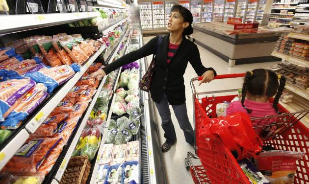 FILE - In this Oct. 15, 2009 file photo, Kolleen Irwin and her daughter Ariel, 3, shop for groceries at a Target store in Philadelphia. The Labor Department reports on U.S. producer prices in March later Friday April 11, 2014. (AP Photo/Matt Rourke, File)