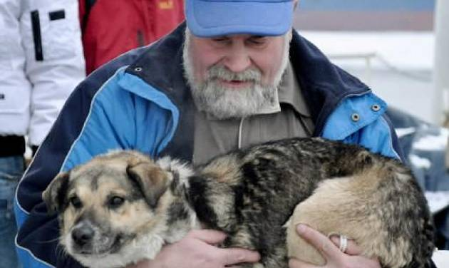 "In this photo taken Tuesday, Jan. 26, 2010 and made available Thursday, Jan 28, 2010 Adam Buczynski carries a dog found floating cold and alone on an ice floe 15 miles off the Polish  Baltic  Sea coast in Gdynia, Poland. Buczynski, a sailor from the ship "" Baltic"" pulled out the dog from the ice floe. (AP Photo/Maciej Czoska)"