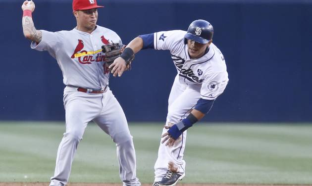 St. Louis Cardinals second baseman Kolten Wong is unable to get off a decent relay after getting a force out on San Diego Padres' Everth Cabrera at second base in the first inning of a baseball game Wednesday, July 30, 2014, in San Diego.  (AP Photo/Lenny Ignelzi)