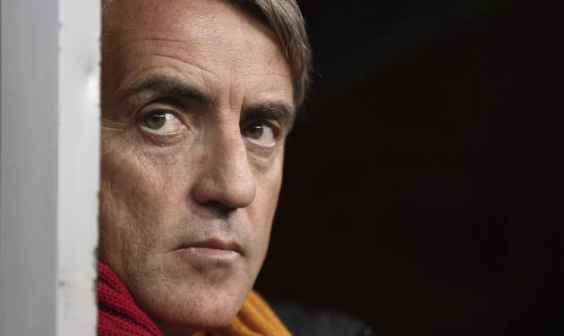 FILE - This is a Tuesday, Dec. 10, 2013. file photo of  Galatasaray's manager  Roberto Mancini watches his team during their Champions League Group B soccer match against Juventus, at the TT Arena Stadium in Istanbul, Turkey.  Mancini  quit as manager of Galatasaray on Wednesday June 11, 2014. (AP Photo)