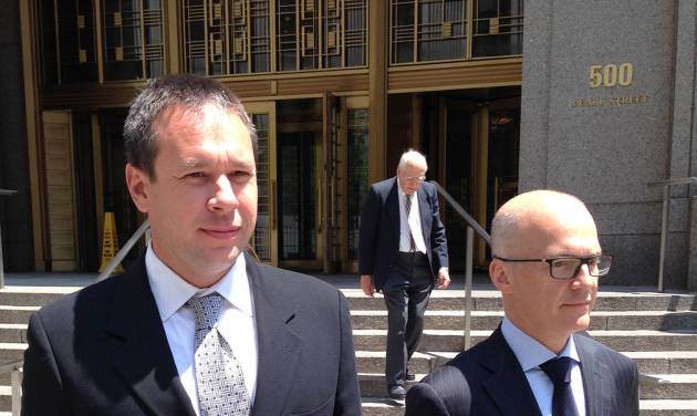 Eric Prokopi, left, of Williamsburg, Va., leaves federal court in New York, Tuesday, June 3, 2014, after he was sentenced to three months in prison for illegally importing a 70 million-year-old dinosaur skeleton into the United States from Mongolia. The assembled Tyrannosaurus skeleton was sold by Dallas-based Heritage Auctions for more than $1 million before it was seized by the U.S. government and returned to Mongolia. At right is his attorney, Georges Lederman. (AP Photo/Larry Neumeister)
