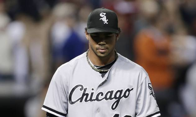 Chicago White Sox relief pitcher Ramon Troncoso walks back to the dugout after giving up a game-winning solo home run to Cleveland Indians' Jason Giambi in the ninth inning of a baseball game, Monday, July 29, 2013, in Cleveland. The Indians won 3-2. (AP Photo/Tony Dejak)