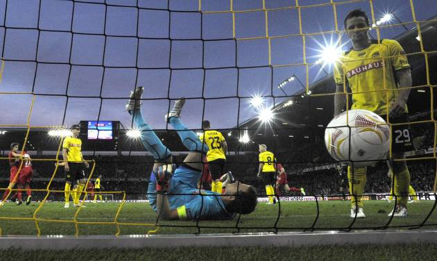 Yopung Boys' goalie Marco Woelfli lies on his back after Liverpool's Andre Wisdom scored the 1-2 during the UEFA Europa League Group A soccer match between BSC Young Boys Bern and Liverpool FC at the Stade de Suisse in Bern, Switzerland, Thursday, September 20, 2012. (AP Photo/Peter Klaunzer/Keystone)