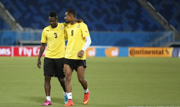 Ghana's Asamoah Gyan, left, and Kevin-Prince Boateng converse during an official training session the day before the group G World Cup soccer match between Ghana and the United States at the Arena das Dunas in Natal, Brazil, Sunday, June 15, 2014.  (AP Photo/Dolores Ochoa)