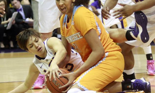 LSU guard Rina Hill, left, fights Tennessee center Mercedes Russell (21) for a loose ball in the first half of an NCAA college basketball game in Baton Rouge, La., Thursday, Feb. 27, 2014. (AP Photo/Tim Mueller)