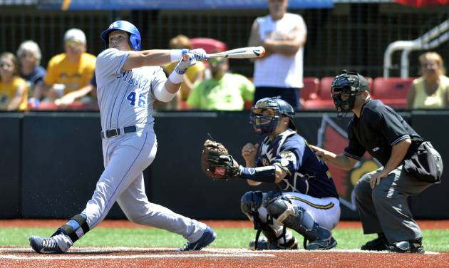 Kentucky's Thomas Bernal hits a 2-run double in the ninth inning of an NCAA college baseball regional tournament game in Louisville, Ky., Saturday, May 31, 2014. Kentucky Defeated Kent State 4-2. (AP Photo/Timothy D. Easley)